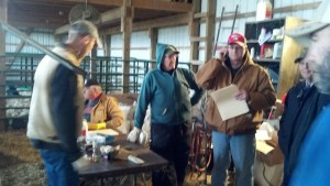 Dr, Kreuger on left assisting with calf check in.